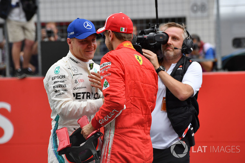 Pole sitter Valtteri Bottas, Mercedes-AMG F1 and third place Sebastian Vettel, Ferrari celebrate in parc ferme