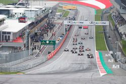Callum Ilott, ART Grand Prix leads the field up to turn one at the start of the race