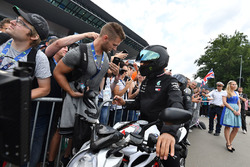 Lewis Hamilton, Mercedes-AMG F1 on his MV Agusta motorbike and fans