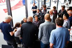 Romain Grosjean, Haas F1 Team, speaks to the media, including commentator Ben Edwards and photographer Jean-Francois Galeron