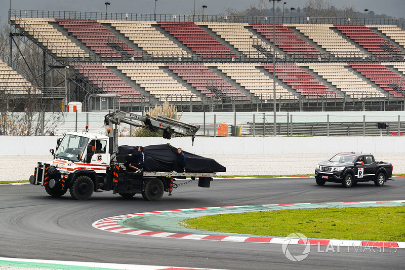 The car of Nikita Mazepin, Force India VJM11 is returned to the pits