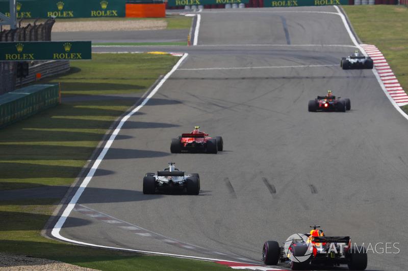 Kimi Raikkonen, Ferrari SF71H, Lewis Hamilton, Mercedes AMG F1 W09, and Daniel Ricciardo, Red Bull Racing RB14 Tag Heuer