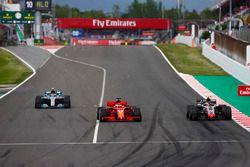 Kevin Magnussen, Haas F1 Team VF-18, Sebastian Vettel, Ferrari SF71H y Valtteri Bottas, Mercedes AMG F1 W09