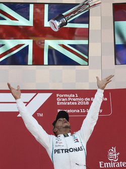 Lewis Hamilton, Mercedes AMG F1, 1st position, throws his trophy in the air in celebration