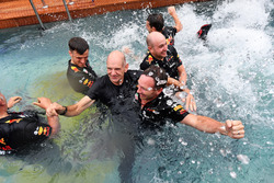 Adrian Newey, Red Bull Racing and Christian Horner, Red Bull Racing Team Principal celebrate in the Red Bull Energy Station swimming pool
