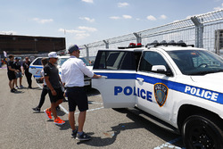 Mitch Evans, Jaguar Racing, gets a ride with New York City police