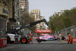 The crashed car of Esteban Ocon, Force India VJM11 is recovered