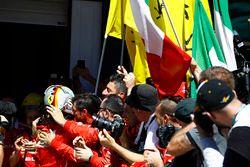 Sebastian Vettel, Ferrari SF70H, celebrates with his team after winning the race