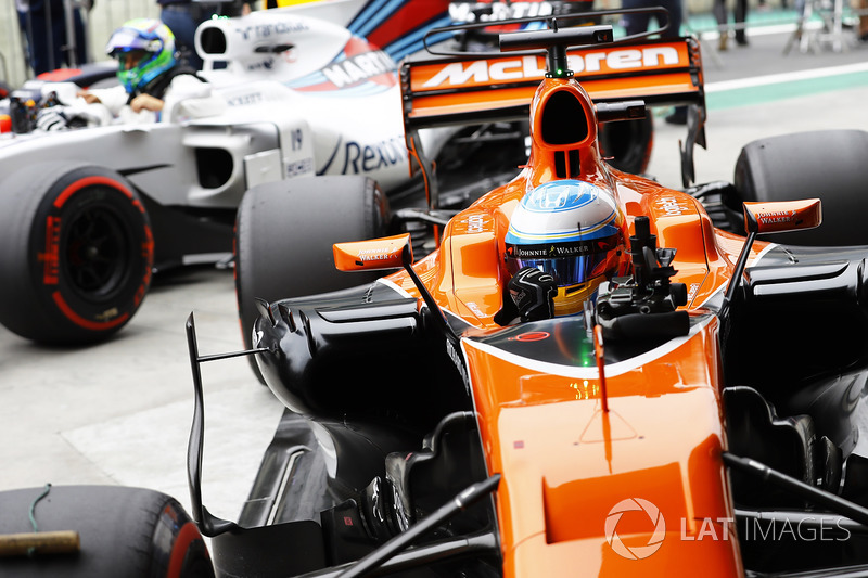 Fernando Alonso, McLaren MCL32, celebrates as he returns to Parc Ferme with Felipe Massa, Williams F