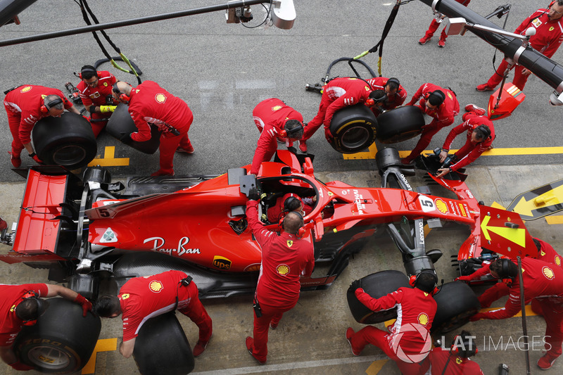 Ferrari engineers practice a pit stop