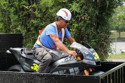 Marshal sits on Cal Crutchlow, Team LCR Honda crashed bike