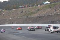 Honda drivers and riders driving around Motegi Circuit