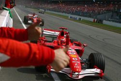 Race winner Michael Schumacher, Ferrari, second place Felipe Massa, Ferrari