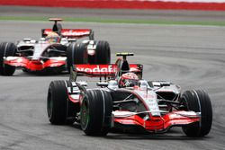 Heikki Kovalainen, Mclaren MP4/23 leads team mate Lewis Hamilton, McLaren Mercedes MP4/23