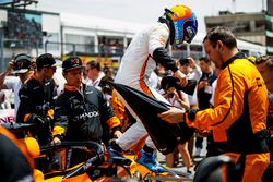 Fernando Alonso, McLaren, jumps out of his car on the grid