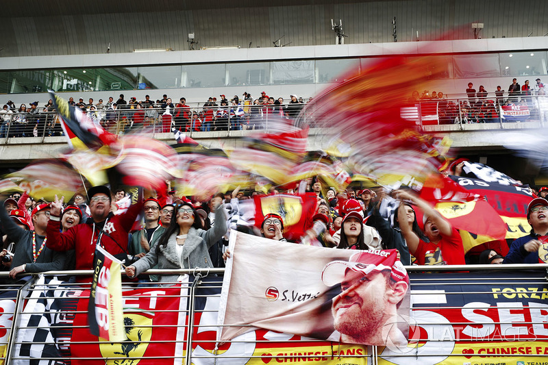 Fans of Sebastian Vettel, Ferrari, wave flags