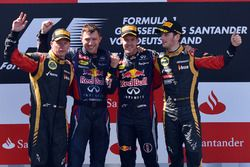 Kimi Raikkonen, Lotus F1, Joe Robinson, Red Bull Racing Mechanic, Sebastian Vettel, Red Bull Racing and Romain Grosjean, Lotus F1 celebrate on the podium