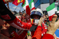 Race winner Sebastian Vettel, Ferrari, celebrates with his team in Parc Ferme