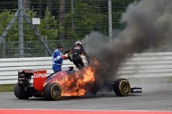 Daniil Kvyat, Toro Rosso STR9 Renault, his car catches fire