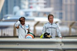Nico Rosberg, Mercedes AMG, and Narain Karthekeyan, HRT, after their collision