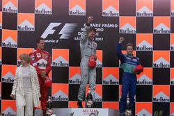 Podium: race winner David Coulthard, McLaren, second place Michael Schumacher, Ferrari F1, third pl