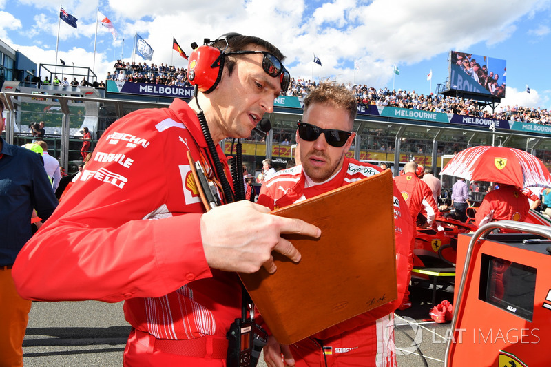 Sebastian Vettel, Ferrari and Riccardo Adami, Ferrari Race Engineer on the grid