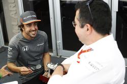 Fernando Alonso, McLaren, talks to Eric Boullier, Racing Director, McLaren, after collecting an award