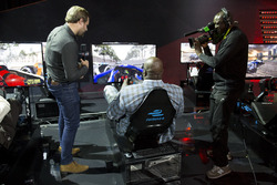 Jack Nicholls commentates on basketball legend Shaquille O'Neal's efforts on the Formula E simulator