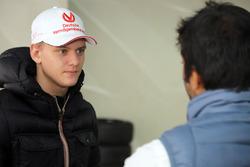 Mick Schumacher with Narain Karthikeyan
