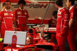 Sebastian Vettel, Ferrari, watches a screen from the cockpit of his car, which is fitted with a new