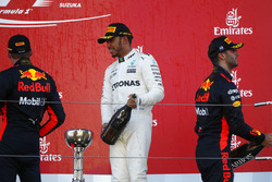 Race winner Lewis Hamilton, Mercedes AMG F1, second place, Max Verstappen, Red Bull, , third place Daniel Ricciardo, Red Bull Racing, with Champagne on the podium