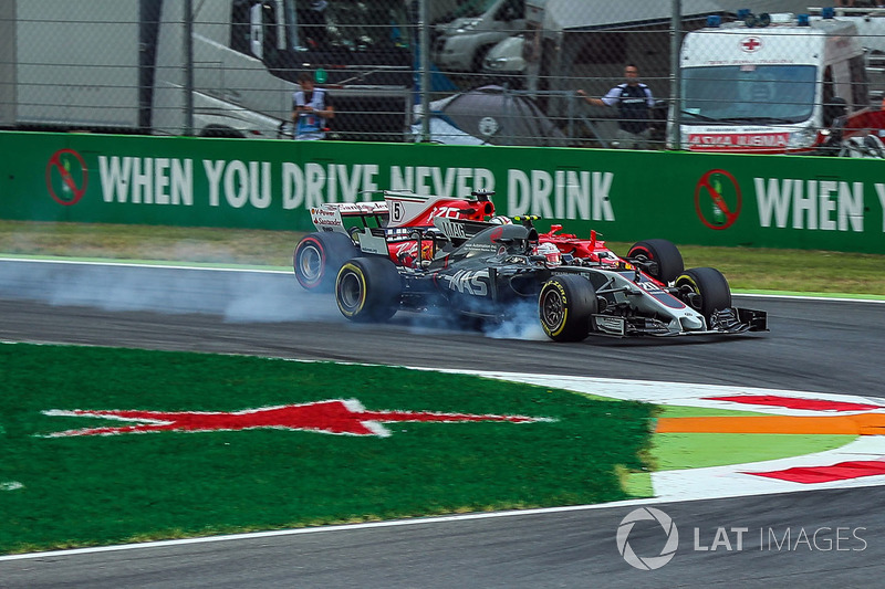 Kevin Magnussen, Haas F1 Team VF-17 y Sebastian Vettel, Ferrari SF70H