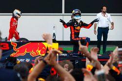 Daniel Ricciardo, Red Bull Racing, celebrates his victory in parc ferme ahead of Sebastian Vettel, F