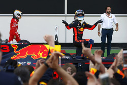 Daniel Ricciardo, Red Bull Racing, celebrates his victory in parc ferme ahead of Sebastian Vettel, Ferrari