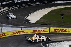 Sebastian Vettel, rounds the corner ahead of Tom Kristensen, driving the the Radical SR3 RSX