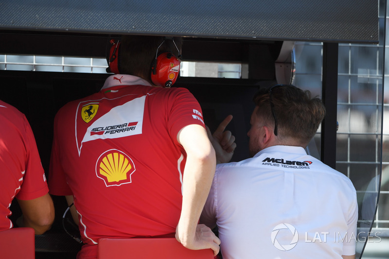 McLaren personel on Ferrari pit wall gantry