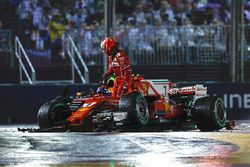 Kimi Raikkonen, Ferrari SF70H leaves his car after his collision, Max Verstappen, Red Bull Racing RB