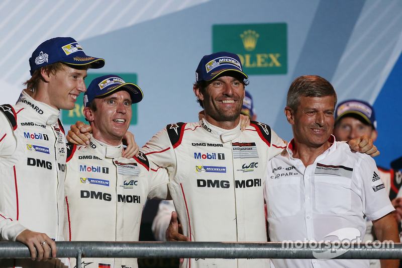 Podium: race winners Timo Bernhard, Mark Webber, Brendon Hartley, Fritz Enzinger, Vice President LMP1, Porsche Team