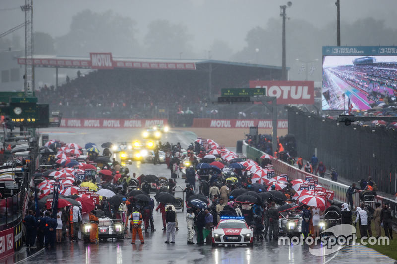Rainstorm breaks as the field comes back to the starting grid