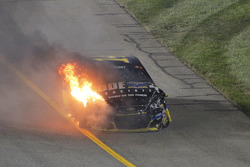 The car of Tony Stewart, Stewart-Haas Racing on fire after crashing