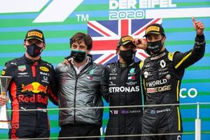 Lewis Hamilton, Mercedes-AMG F1, 1st position, Max Verstappen, Red Bull Racing, 2nd position, and Daniel Ricciardo, Renault F1, 3rd position, celebrate on the podium