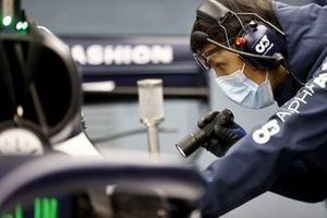 An AlphaTauri engineer works on Yuki Tsunoda, Honda Formula Dream Projects car