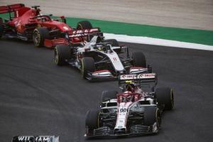Antonio Giovinazzi, Alfa Romeo Racing C39, Romain Grosjean, Haas VF-20, and Sebastian Vettel, Ferrari SF1000