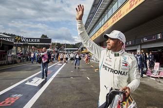 Pole man Lewis Hamilton, Mercedes AMG F1, waves to fans