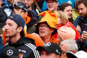 A Dutch fan in an orange hat