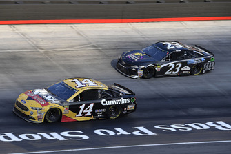 Clint Bowyer, Stewart-Haas Racing, Ford Fusion Rush Truck Centers/Cummins and Blake Jones, BK Racing, Toyota Camry Tennessee XXX Moonshine