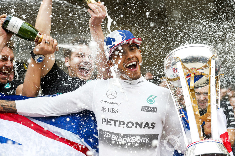 Lewis Hamilton, Mercedes AMG, celebrates after securing a third World Drivers Championship victory