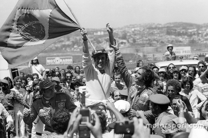 The podium (L to R): Jochen Mass, McLaren, third: his first points and podium finish; Carlos Pace, Brabham, celebrating his first and only GP victory; Emerson Fittipaldi, McLaren, second