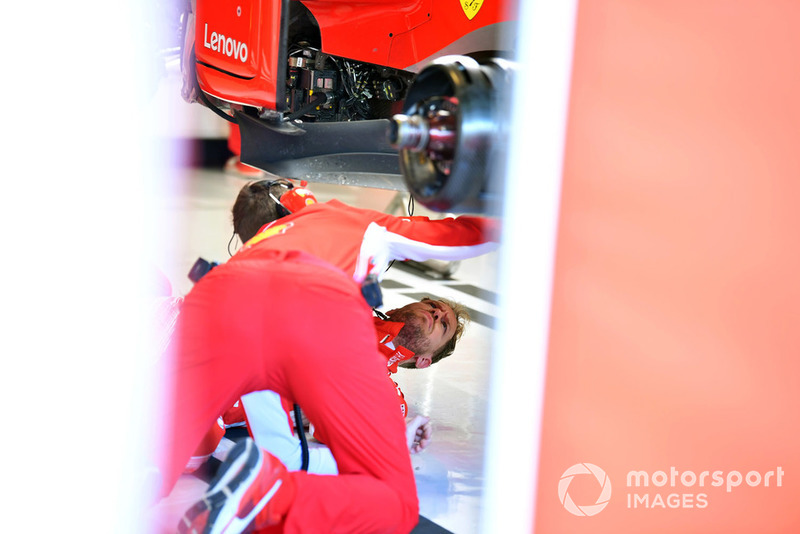 Sebastian Vettel, Ferrari on the garage floor under the Ferrari SF71H