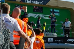 Lando Norris, McLaren, 2nd position, performs a shoey on the podium